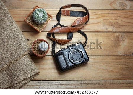cameras and Cactus on wooden tables