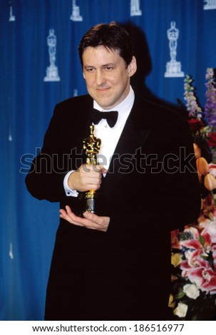Cameron Crowe holding his Oscar for Best Screenplay at Academy Awards, 3/25/2001