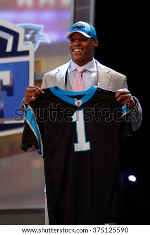 Cameron Newton (R) is introduced as the first pick to the Carolina Panthers at the NFL Draft 2011 at Radio City Music Hall in New York, NY. - stock photo