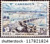 "CAMEROON - CIRCA 1956: A stamp printed in France from the ""Economic and Social Development Fund"" shows R. Wouri bridge, circa 1956. - stock photo"