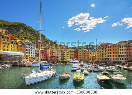 Camogli marina harbor, boats and typical colorful houses. Travel destination Ligury, Italy, Europe. - stock photo