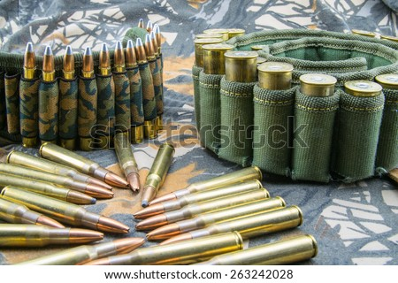 camouflage ammunition belts for rifle - stock photo