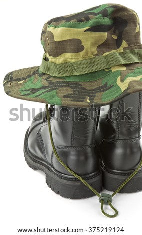 Camouflage hat and boots military equipment of the Armed Forces - stock photo