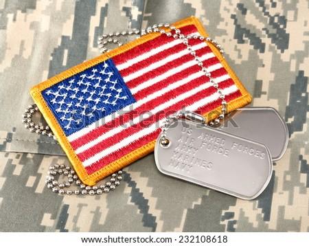 Camouflage uniform, dog tags, American Flag - stock photo