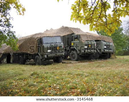 Camouflaged cars. Army - stock photo