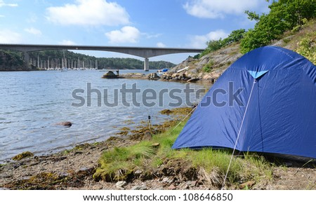 Camp close to the water - stock photo