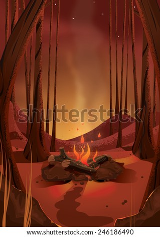 Camp fire in the woods. A hot burning camp fire in the outdoors, logs burning and stones surround this camping fire. - stock photo