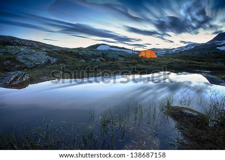 Camp in the Hardangervidda Nationalpark in Norway at Night - stock photo