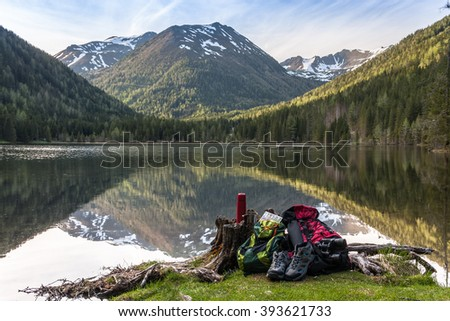 Camp in the mountains near of the lake. Bivouac on the lake in the Alps