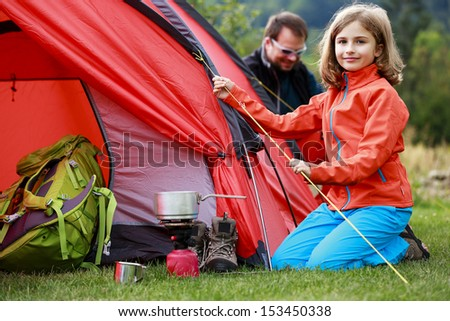 Camp in the tent - family setting a tent on the camping - stock photo