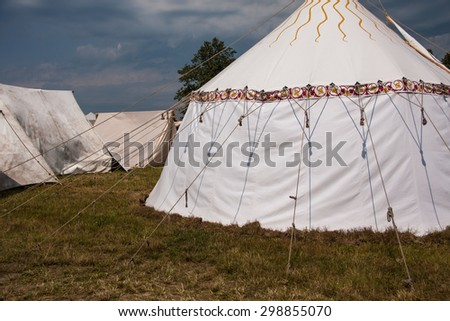 Camp knight with white tents