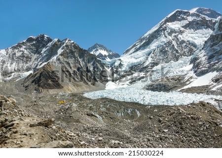 Camp of climbers on Khumbu glacier near legendary place Everest Base Camp - Nepal, Himalayas - stock photo