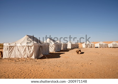 Camp of tents in the desert of Sahara, South Tunisia - stock photo