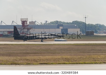 CAMP SPRINGS, MD, USA - SEPTEMBER 19, 2015: U-2 spy plane lands after performing during the 2015 Joint Base Andrews Air Show held at Joint Base Andrews in Camp Springs Maryland. - stock photo