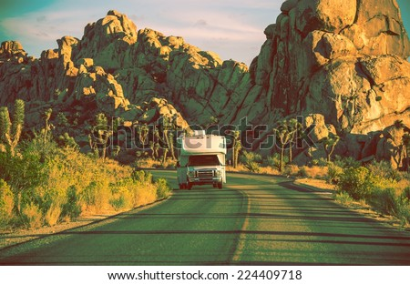 Camper in California. RVing in Souther California. Joshua Trees National Park Landscape. Vintage Color Grading. - stock photo