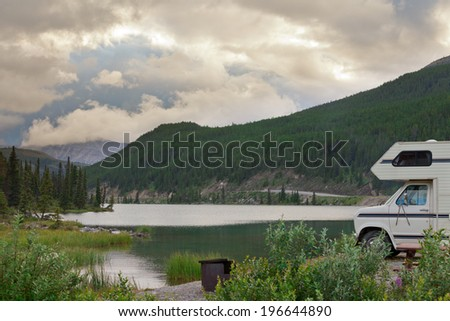 Camper van parked on Summit Lake Campground in Stone Mountain Provincial Park, highest point of the Alaska Highway, northern BC, Canada - stock photo