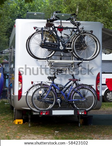 camper with bicycles on a camping site - stock photo