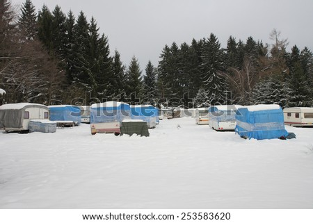 campers covered snow in winter - stock photo