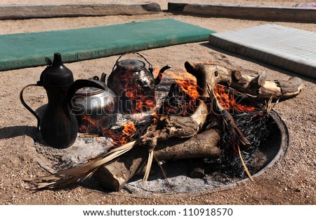 Campfire in the Negev desert, Israel. - stock photo