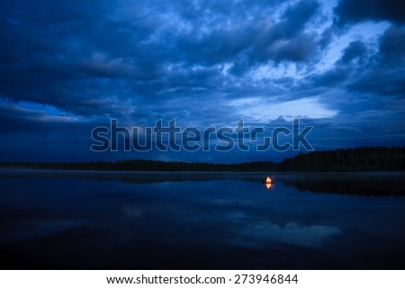 Campfire on the lake - stock photo
