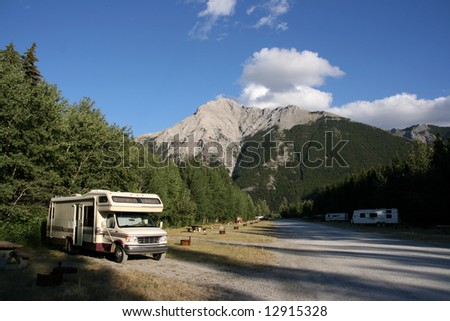 Campground near Crowsnest Pass. Beautiful landscape of Canada. Parked RV car.