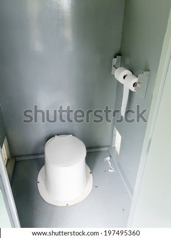 Campground pit toilet outhouse inside white plastic toilet and dirty interior to the toilet bowl - stock photo