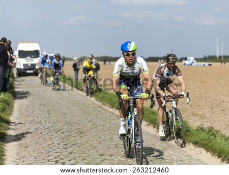CAMPHIN EN PEVELE,FRANCE-APR 13:The cyclist Michael Hepburn from Orica GreenEdge riding on the cobblestone sector Carrefour de Arbre in Camphin-en-Pevele on April 13 2014 during Paris-Roubaix  - stock photo