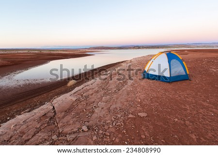 Camping Adventure on the Desert Shore of Lake Powell (Glen Canyon National Recreation Area in Arizona and Utah) - stock photo