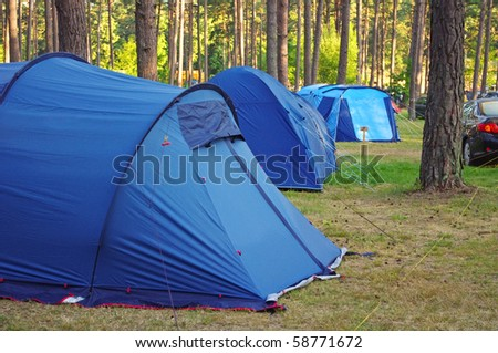camping and tents on the grass in the summer - stock photo