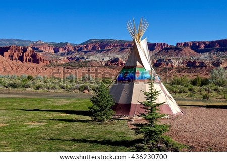 Camping at First Nation Teepee at American Wild West.  Colourful Red Rocks at Capitol Reef National Park, Utah, USA.  - stock photo
