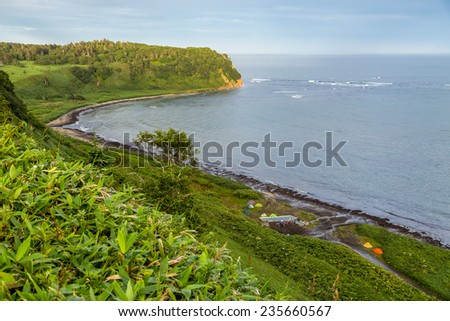 Camping at the Pacific ocean coast from the hill top, Kunashir island, Russia