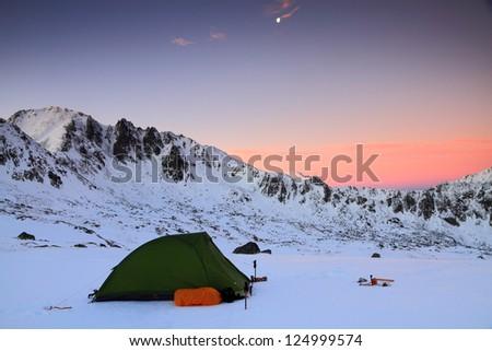 Camping before sunrise in winter time, Retezat mountains, Romania - stock photo