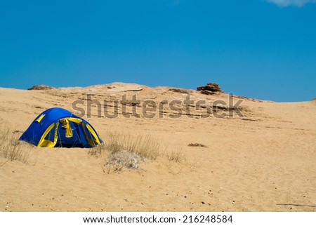 Camping between the desert dunes on the beach - stock photo