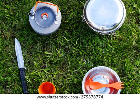 Camping equipment on the grass - stock photo