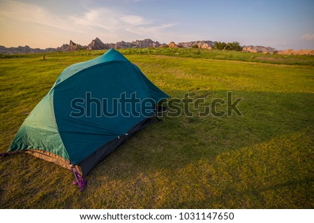 C&ing in Badlands National Park green tent summer vacation outdoors c& mountains rugged landscape sunrise sunset & Yellow And Blue Tent Stock Images Royalty-Free Images u0026 Vectors ...