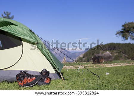 Camping in the mountains on a sunny day.