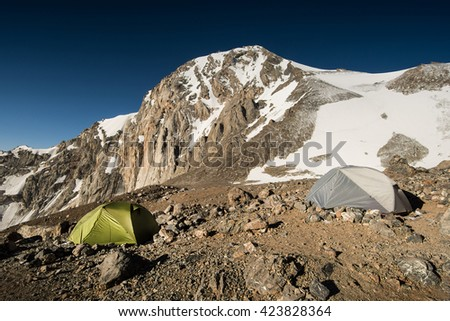 Camping in wild high mounitains in Kyrgyzstan, Central Asia - stock photo
