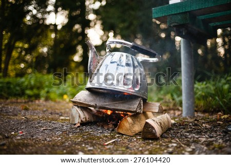 Camping iron kettle. - stock photo