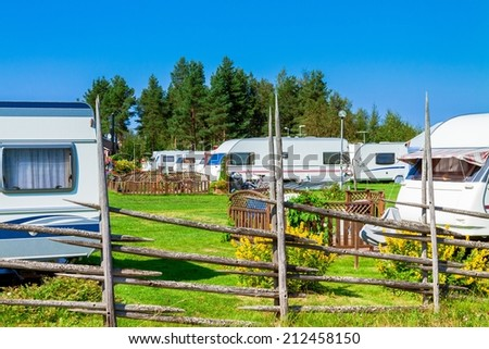 Camping life with caravans in nature park - stock photo