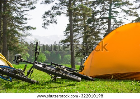 camping near mountains in summer - stock photo