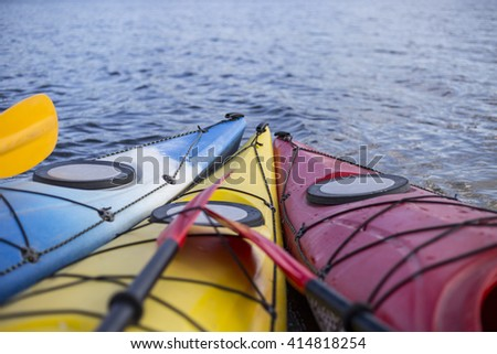 Camping on the beach.Kayak on the beach on a sunny day. - stock photo