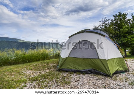 Camping Setup with Tent Outdoors - stock photo