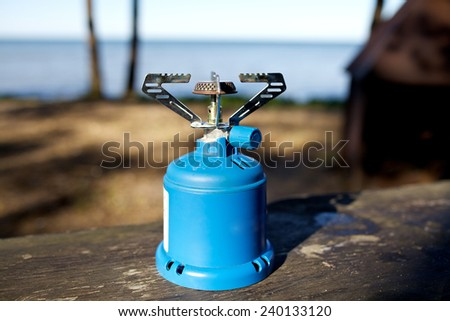 Camping Stove on wood table - stock photo