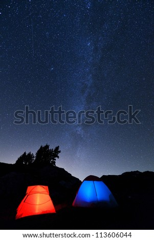 Camping tent and Milky Way on Yellow Aster Butte, North Cascades - stock photo