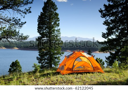 Camping Tent by Lake - stock photo