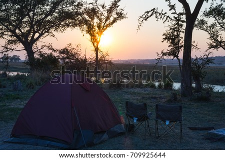 C&ing tent chairs and c&ing gear. Sunrise over Okavango River Namibia Botswana border & Springtime Home Gardening Trimming Planting Flowers Stock Photo ...