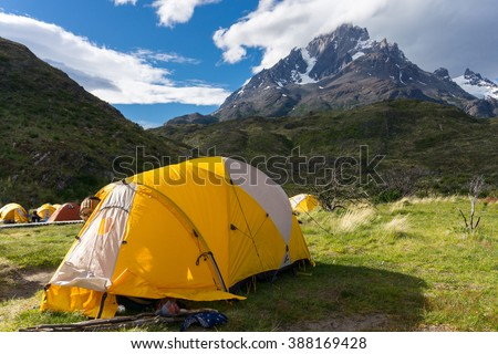 Camping tent in front of mountain - stock photo
