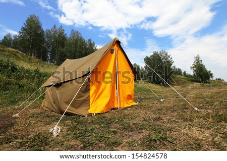 Camping tent on outdoor nature. Tourism concept - stock photo