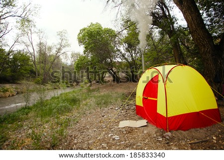 Camping tent sauna near river - stock photo