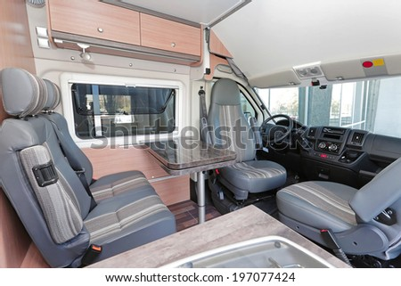 Camping van interior with seating for four